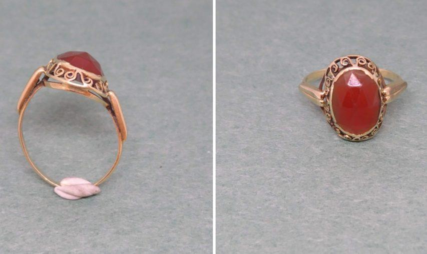 vervormde ring met granaat